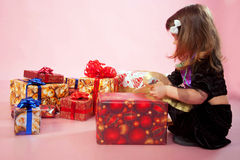 Child looking on Christmas gifts Stock Photos