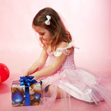 Child looking on Christmas gifts Stock Photography