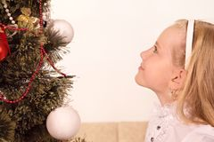Child Looking at the Christmas Tree. Little girl looking at the top of the Christmas Tree Royalty Free Stock Photo