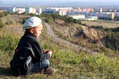 Child is looking on city from altitudes Stock Photos