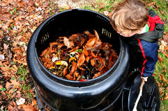 Child looking in compost bin Royalty Free Stock Photography