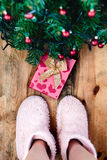 Child looking down at present under Christmas tree Royalty Free Stock Photo