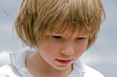Child looking downwards Royalty Free Stock Images