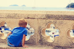 Child looking at Dubrovnik from old city walls Royalty Free Stock Photos