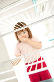 Child looking in empty fridge Royalty Free Stock Image