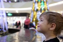 Child looking at fountain Stock Photos