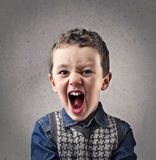 Child looking at the front and screaming Stock Photo