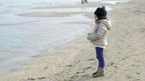 Child looking and gazing staring at the Sea in winter nostalgic scene