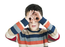 Child looking through his hands Stock Photography