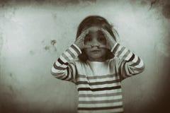 Child looking through imaginary binocular Royalty Free Stock Image