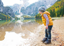 Child looking on lake braies in south tyrol Stock Images