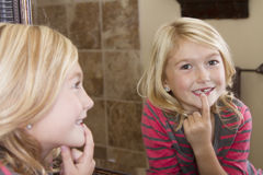 Child looking in mirror at missing front tooth Stock Photography