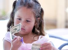 Child Looking at Money Royalty Free Stock Photos