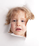 Child looking out of a hole Stock Photography
