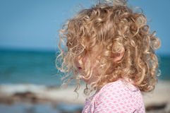 Child looking out towards the sea Royalty Free Stock Image