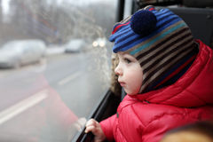 Child looking out the window Stock Photography