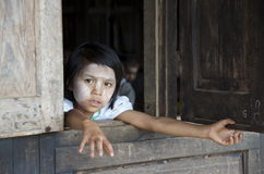 Child looking out the window of school. Burma Stock Photos