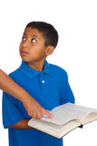 Child Looking at Person While Holding Bible  Stock Photography