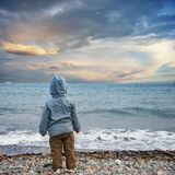 Child looking at the sea Royalty Free Stock Image
