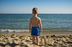 Child looking at sea Stock Photos