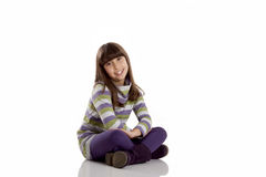 Child looking serious. In a white background Stock Photos