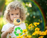 Child looking at spring flowers Stock Photography