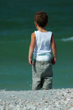 Child looking at surf Royalty Free Stock Photo