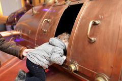 Child looking at tank Royalty Free Stock Photo