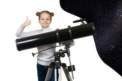 Child Looking Into Telescope Star Gazing Little girl. Isolated on a white background royalty free stock images
