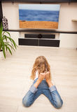 Child looking at television Royalty Free Stock Photos