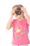 Child looking thru donut Stock Photography
