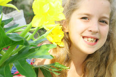 Child looking thru flowers Royalty Free Stock Photography