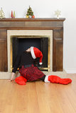 Child looking up fireplace for santa Royalty Free Stock Photos