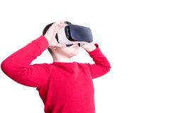 Child looking through virtual reality glasses Stock Images
