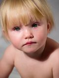 Child looks attentively. Child looks on camera attentively royalty free stock images