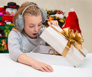 Child looks in a box with a gift on Christmas. Royalty Free Stock Photography