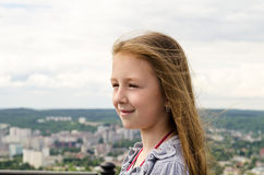 The child looks at the city. From height Royalty Free Stock Images