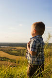 Child looks into the distance Royalty Free Stock Photos