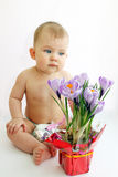 Child it looks at flowers Stock Photography