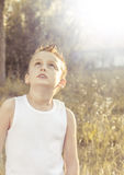 Child looks intrigued into the sky royalty free stock photos