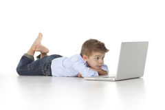 Child looks at laptop Royalty Free Stock Images