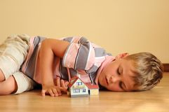 Child looks model a house Royalty Free Stock Photo