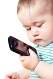 Child looks at the phone and thought Stock Images
