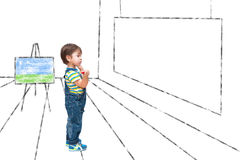 The child looks at a picture. Of a blank Stock Photos