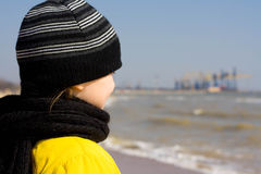 Child looks at the sea. Royalty Free Stock Images