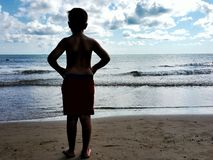 A child looks at the sea Royalty Free Stock Images
