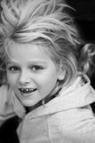 Child losing her first tooth. 8 year old girl just lost her first milktooth. Black and white photo Stock Photography