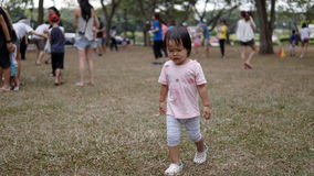 Child losing her temper after losing a game. Child losing her temper and walks away after losing a game Stock Photography