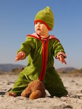 Child losing teddy bear. Child playing with teddy bear at the beach Royalty Free Stock Images