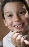 Child with lost tooth Stock Photos